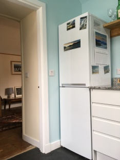 High doorway to sitting room; new fridge-freezer