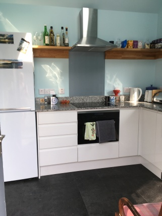 Kitchen now has drawers and an extractor fan.